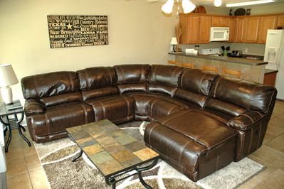 Napping Station 3000, sleep inducing reclining leather sectional.   3 recliners.