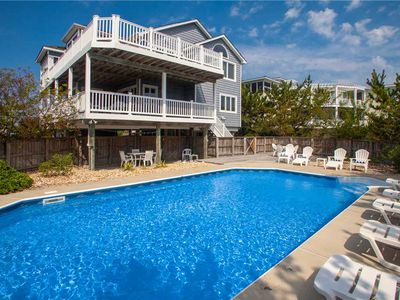 Photo for Beautiful, coastal themed 5 bedroom home with private pool, just a short walk to the beach