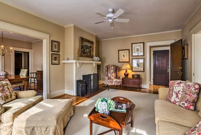 The apartment is furnished with antiques and original artwork.