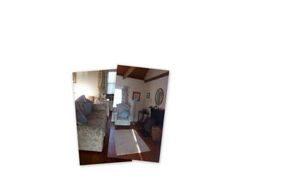 Marian Cottage living room area with sofa bed and wood burner