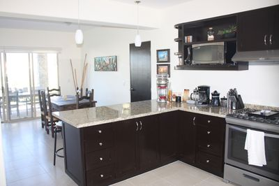 Fully stocked kitchen with new appliances, and granite counter tops