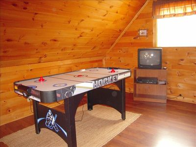The game room is in the loft where you can enjoy air hockey, TV  and futon