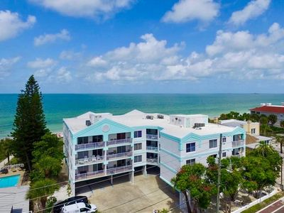 Photo for Waterfront, beachy condo w/ a shared, heated pool, amazing views - walk to dock!