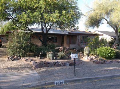 Front view of mid-century ranch style home with desert landscaping