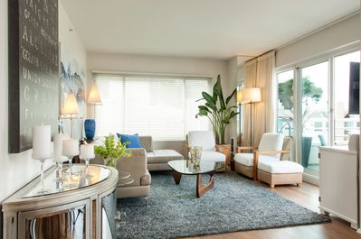 COMFORTABLE MODERN LIVING ROOM... AIRY AND BRIGHT WITH WORLD CLASS WATER VIEWS.