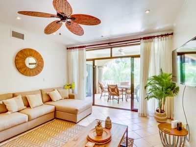 Photo for Bright condo with shared pool -walk to dining, shopping & the beach