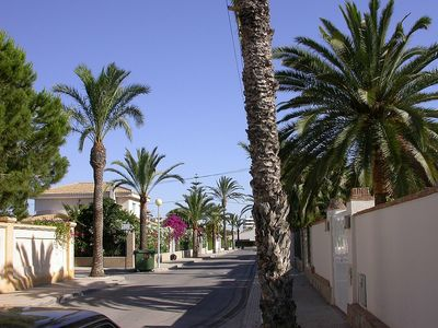 Photo for 5 bed (all with A/C) 4 bath detached villa ,priv pool 2 min to cabo roig beach.