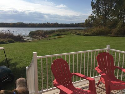 Large Sun deck with 2 patio tables and chairs