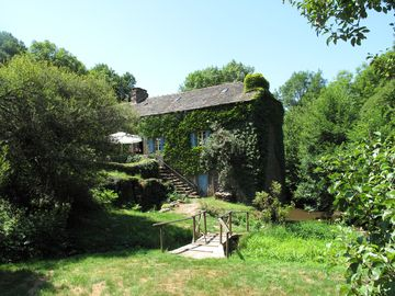 Romantic watermill in idyllic setting
