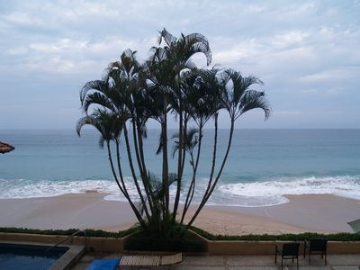 Photo for Beautiful beachfront condo with heated pool and white sand beach.