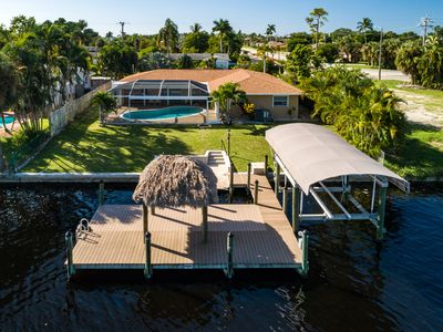 Photo for NEW LISTING! Beautiful 4BR Gulf access villa w/pool, dock, tiki hut – Yacht Club