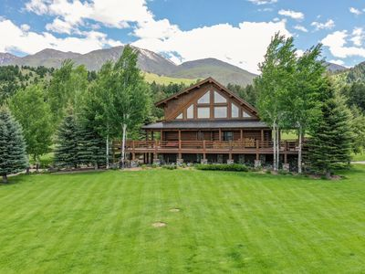 Luxury log home nestled in the mountains with creek & pond, year round rental