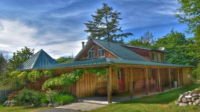 Photo for Private Handcrafted Log Home with gardens and hot tub!