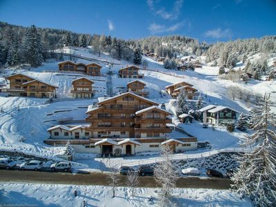 Photo for Matins St Laurent 1b - Ski-in & ski-out luxury 4-star apartment for 4 people