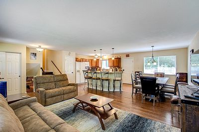 Open concept flow throughout kitchen, living area, and dining.
