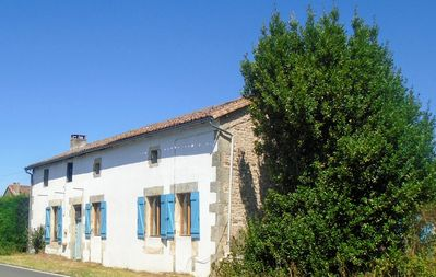 Photo for Rural Farmhouse with Spacious Garden near Charroux