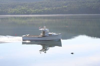 Lobster boat passing by the cottage