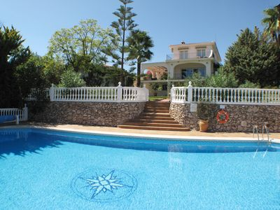 Photo for Spectacular 6-bed Villa, huge 18m heated pool, stunning mountain & sea views
