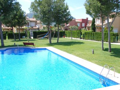 Photo for Holiday home with communal swimming pool and large garden, near golf course
