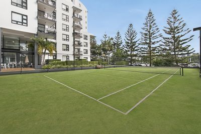 Your apartment overlooks the floodlit  tennis court.