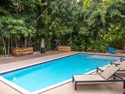 Photo for Tropical Bungalow on 1 acre lush landscape and heated pool