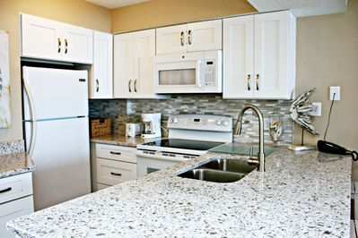 Fully renovated kitchen with new quartz counters, new appliances, new fixtures