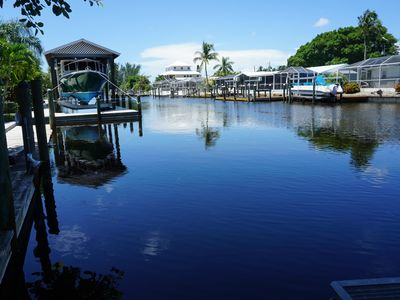 Photo for NEW HEATED POOL, WATERFRONT HOME W/ BOAT LIFT! 3 Bedrooms, 2 full baths, split