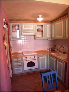 Kitchenette with oven and dish washer.