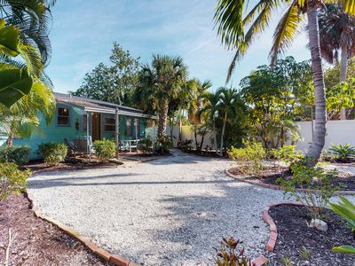 Photo for Cozy, historic beach cottage moments away from the beach and free trolley stops!