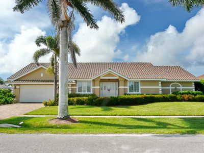 Photo for Peaceful waterfront home w/ heated pool & direct boating access