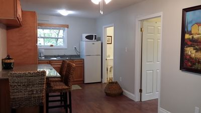 Kitchen area in bungalow comes fully equipped & has breakfast bar