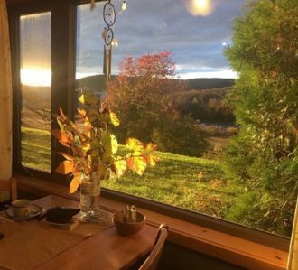 Dining room picture window at sunset