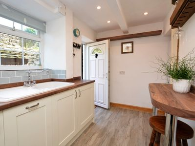A warm welcome awaits in the stylish kitchen