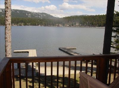 view from the deck of the cabin of the yard, dock, and beach!