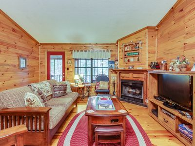 Photo for Dog-friendly cabin in the woods w/ private hot tub, screened-in deck & BBQ