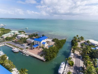 Photo for Four bedroom ocean-front home with pool, spa, boat lift and luxury living!