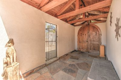 Courtyard entrance to gated villa.  Private patio to the front and to the side.