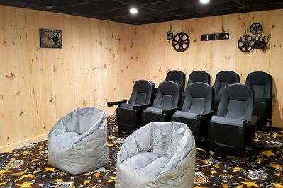 """Large theater room w/theater seating & cupholders, surround sound, 80"""" TV, DVD"""
