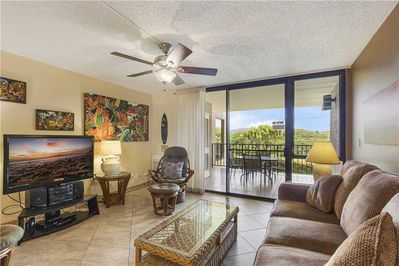 Family Room with a View - Enjoy sitting on the couch and playing a game of cards while listening to the breeze glide through the Hawaiian palms at Kamaole Sands 4-208.