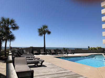 Ocean side swimming pool with new chase lounges