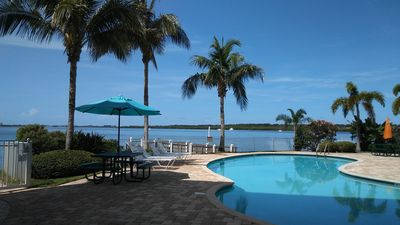 Photo for Boca Ciega Resort & Marina - Watch dolphins frolic from your waterfront balcony