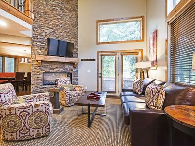 living room with fireplace.  Open to dining and family room