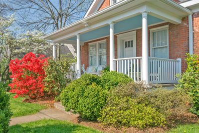 Welcoming front porch with wonderful landscaping