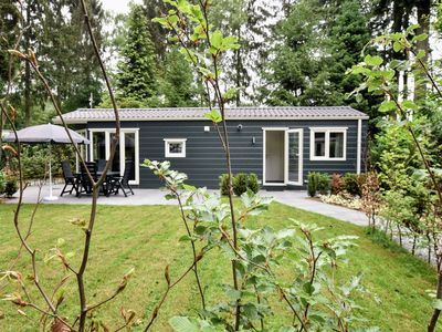 Photo for Modern chalet in green surroundings on a holiday park on the edge of the woods