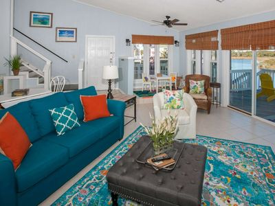 Photo for Adorably decorated home on canal | Stone fireplace for grilling, Wifi, Boat Dock, Sandy Beach Area