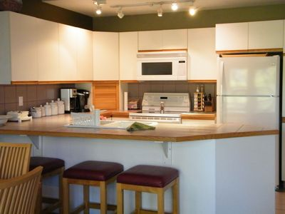 Bright and well-provisioned kitchen
