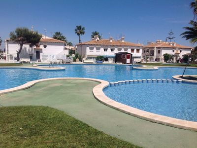 Photo for Well Presented Property, Sleeps 6, Large Communal Pool Close To All Amenities