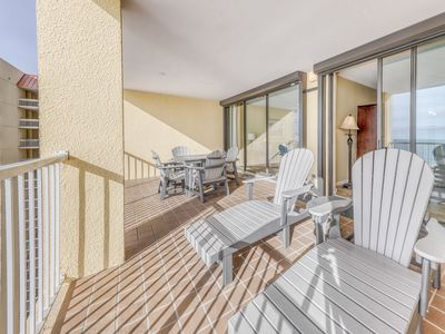 Photo for Gorgeous, beachfront condo w/ an open layout, shared pools, tennis, & gym