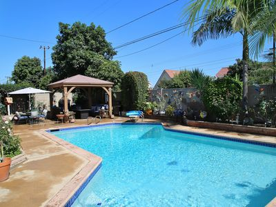 Photo for Cozy family/pool home near beach and 20 min from Disney with Harbor boat tour