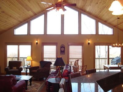 Living room with vaulted ceilings, gas log fireplace and TV